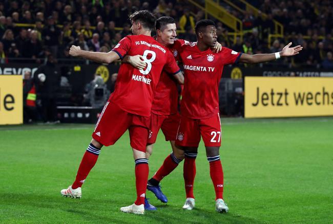 莱万+罗伊斯各两球 拜仁两度领先客场负多特